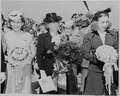 Bess Truman, Margaret Truman and another woman, standing with bouquets during the christening ceremony for two... - NARA - 199104.tif