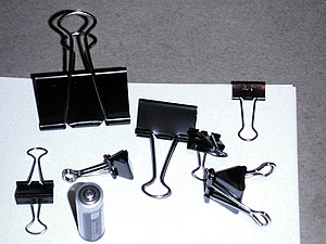 Binder clip - An assortment of binder clips, with an AA battery for scale