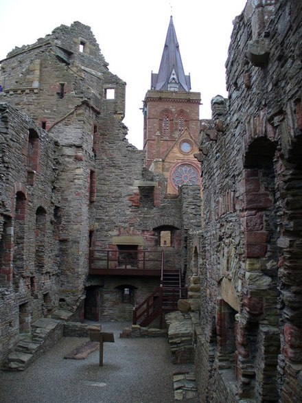 The Bishop's Palace, Kirkwall in Orkney where Haakon Haakonarson, the last Norwegian king to rule over the Sudreyjar died in 1263.[94] The spire of St Magnus Cathedral can be seen in the background. - Kingdom of the Isles