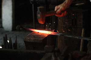 Blacksmith working hot iron