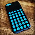 Blue iPhone 5C in black case.jpg