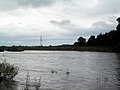 Border Esk after heavy rain, and the stone embankment on the north bank - geograph.org.uk - 954605.jpg