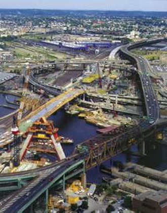 Big Dig - Zakim Bunker Hill Bridge over the Charles River under construction, looking north. The old elevated Central Artery crossing is to the right.