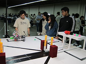 Botball -  Botball 2011 participants practice at the official game table prior to their competitive round.