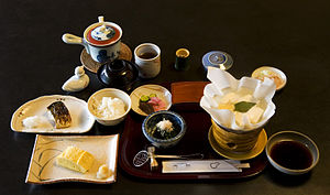 Japanese cuisine - Breakfast at a ryokan (Japanese inn), featuring grilled mackerel, Kansai style dashimaki egg, tofu in kaminabe (paper pot)