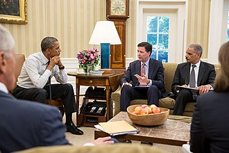 Washington Navy Yard shooting - President Obama receives an update on the shootings investigation from ex-FBI Director James Comey, left, and Attorney General Eric Holder in the Oval Office on September 17, 2013.