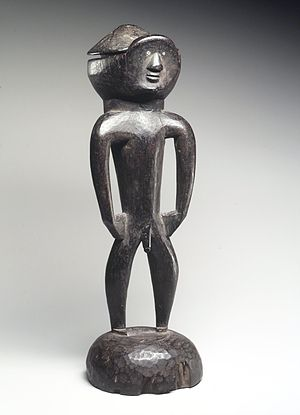 Bassa people (Liberia) - A lid carved from wood, embedded with glass by an early 20th century Bassa artist.