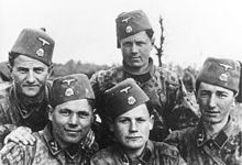 a group photograph of five soldiers wearing SS uniforms and fez headgear