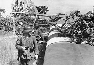 Battle of Bréville - German patrol moving past a crashed Waco Hadrian glider