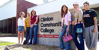 Clinton Community College (Iowa) - Students gather at the sign outside of the entrance to Clinton Community College, IA