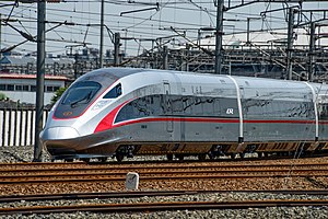 High-speed rail in China - Chinese designed China Standardized EMU departing Beijing South Railway Station.