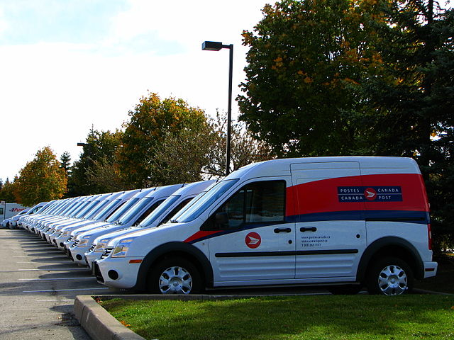 Canada Post vans By Michael Gil from Toronto, ON, Canada (Canada Post's New Fleet  Uploaded by Skeezix1000) [CC BY 2.0 (https://creativecommons.org/licenses/by/2.0)], via Wikimedia Commons