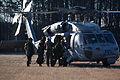 Canadian soldiers with 2nd Battalion, Royal Newfoundland Regiment, 37th Canadian Brigade Group, load onto an MH-60 Seahawk helicopter during Exercise Southern Raider 13, at Fort Pickett, Va., March 4, 2013 130304-A-KH856-066.jpg