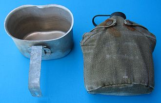Canteen (bottle) - Covered military canteen (right) with nested canteen cup (left)