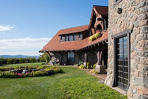 Castle in the Clouds - Facade of the mansion and lawn overlooking Lake Winnipesaukee