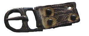 Buckle - A buckle chape; this is the plate on the right. It connects the buckle to the (missing) strap.
