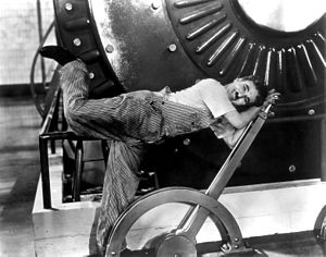 Physical comedy - Physical comedy as Charlie Chaplin wrestles with factory controls in his 1936 comedy Modern Times