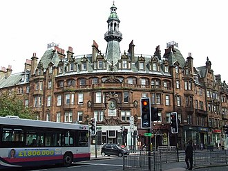Charing Cross, Glasgow - The Charing Cross Mansions, designed by John James Burnet and completed in 1891; the city's first and arguably grandest red sandstone tenement, still dominate Charing Cross today.