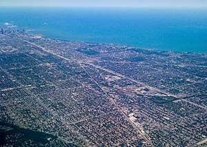 Chicago metropolitan area - Airborne view of the dense southern part of Chicago, running alongside Lake Michigan. Downtown Chicago is at the far left by the lake in the photo.