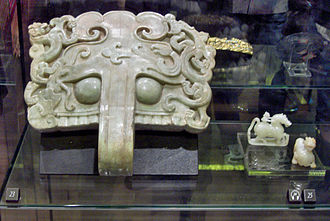 Society and culture of the Han dynasty - A Western-Han jade-carved door knocker with designs of Chinese dragons (and two other jade figurines)