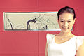 Chinese model posing in front of a Chinese painting (6759435737).jpg