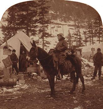 John Clum - U.S. Post Office inspector John Philip Clum in 1898 on mule back visiting Alaskan post office facilities.