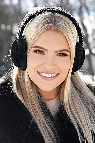 Earmuffs - Woman wearing cold-weather thermal earmuffs