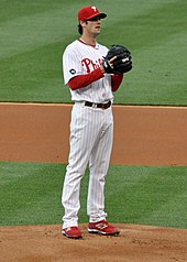 Cole Hamels, wearing the Phillies home uniform from 2010, prepares to throw a ball