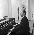 Conductor George de Godzinsky playing a grand piano in a radio studio, ca 1935..jpg