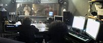 Photo of a recording studio control room during recording, viewing a trumpet part performance in the the studio room, for Witches' Heart of Stone album - http://www.witchesband.