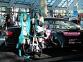 Cosplayers and itasha of Hatsune Miku at Anime Expo 20110701.jpg
