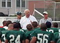 Cowen Talks to the Football Team (3617293181).jpg