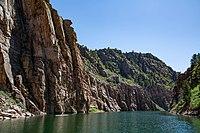 River below a steep rocky cliff