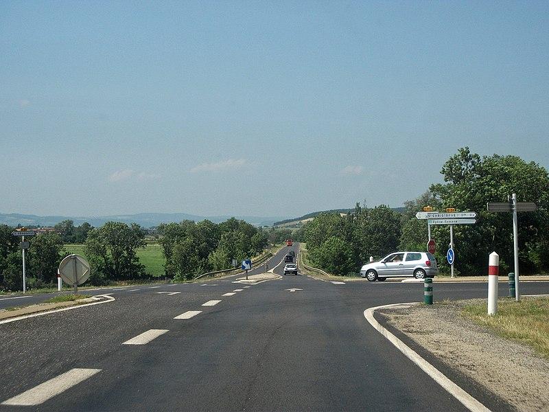 Departmental road 906 towards Clermont-Ferrand and Aurillac, which crosses the dep. rd. 31 deserving Saint-Christophe-sur-Dolaison, Haute-Loire, Auvergne, France. Elevation: 914m/3,000ft.