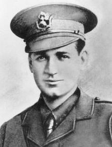 Formal head-and-shoulders portrait of a man in military uniform and cap.