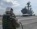 Dave Lorenz, a Northrop Grumman deck operator, drives an X-47B unmanned combat air system using an arm-mounted controller on the flight deck of the aircraft carrier USS George H.W. Bush (CVN 77) in Norfolk, Va 130510-N-FU443-303.jpg