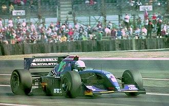 Simtek S941 - Image: David Brabham Simtek S941 leaves the pits at the 1994 British Grand Prix (32388881792)