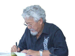 Suzuki signing a copy of his works.