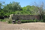 Old Ford 3000 tractor and derelict Oast House at Attwater Farm, Attwaters Lane, Hawkhurst, Kent, near to Gill's Green, Kent, Great Britain.