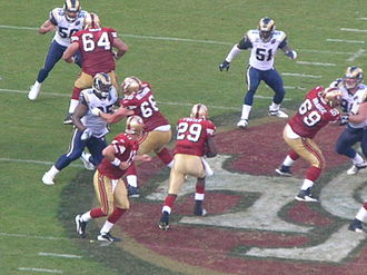 DeShaun Foster - Foster carries the ball against the St. Louis Rams on November 16