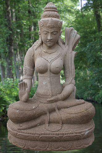 Abhayamudra - Dewi Sri (Parvati) with her right hand in abhaya mudra, Bali Indonesia.