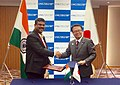 Dharmendra Pradhan and the Minister of Economy, Trade and Industry of Japan, Mr. Hiroshige Seko exchanging after signing a Memorandum of Cooperation (MoC) between India and Japan on establishing a liquid.jpg