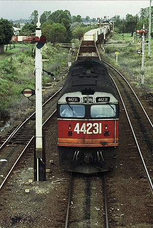 New South Wales 442 class locomotive - 44231 on a northbound freight train arriving at Casino in 1987