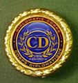 Diplomatic Corps Ambassador Gold Pin.png