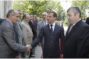 Russia–South Ossetia relations - Russian President Dmitry Medvedev is introduced to members of the South Ossetian government by President of South Ossetia Eduard Kokoity, during a working visit to Tskhinval on 13 July 2009.