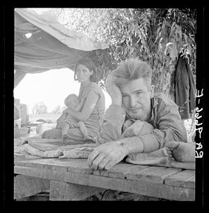 The Harvest Gypsies - Drought refugees from Oklahoma camping by the roadside. They hope to work in the cotton fields. There are seven in the family. Blythe, California.  - Dorothea Lange 1936