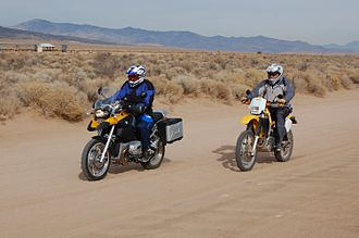 Dual-sport motorcycle - The BMW R1200GS is in front with a Suzuki DRZ400 behind it.
