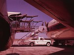 Dules airport mobile lounge telescoping bridgeway resting atop a mobile open gangway 00774v.jpg