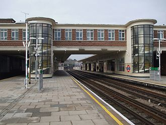 East Finchley tube station - View of platforms with glazed stairwells and offices spanning the tracks
