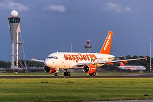 Capitalization - easyJet A319 at Airport Amsterdam Schiphol.